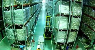 The clip, filmed inside a distribution warehouse, captured the driver as he made his way down an aisle between two tall pallet racks
